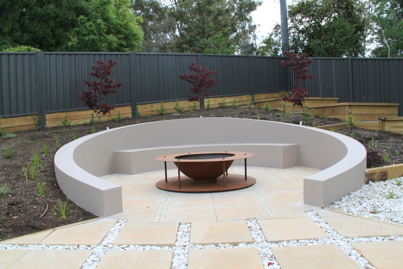 Sunken circular seating area with fire pit janna for Garden designs seating areas