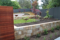 Brand new hard and soft landscaping taking full advantage of the sloping land