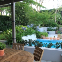 Looking from the terrace over the spa into the garden