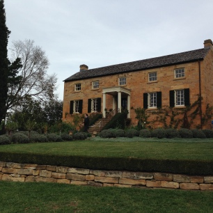 Topiary and immaculate lawns at the front of the house