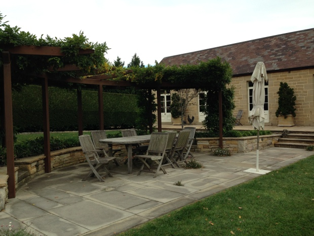 Wisteria covered pergola with outdoor dining area