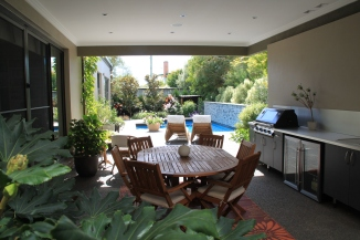 Outdoor entertaining area is integrated into the garden