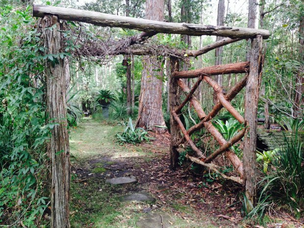 Arbour constructed from fallen trees on site