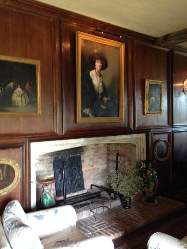 Vita Sackville-West, aged 18, above the fireplace in the Sissinghurst library
