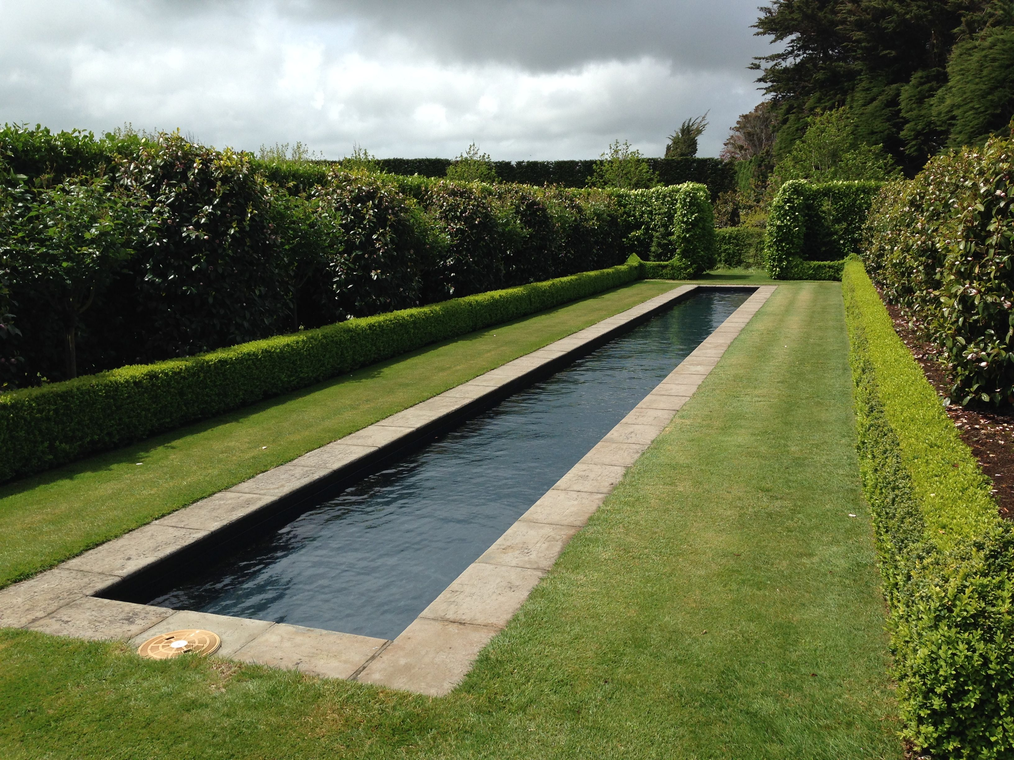 Formality and precision at gravetye garden janna - Reflecting pool ...