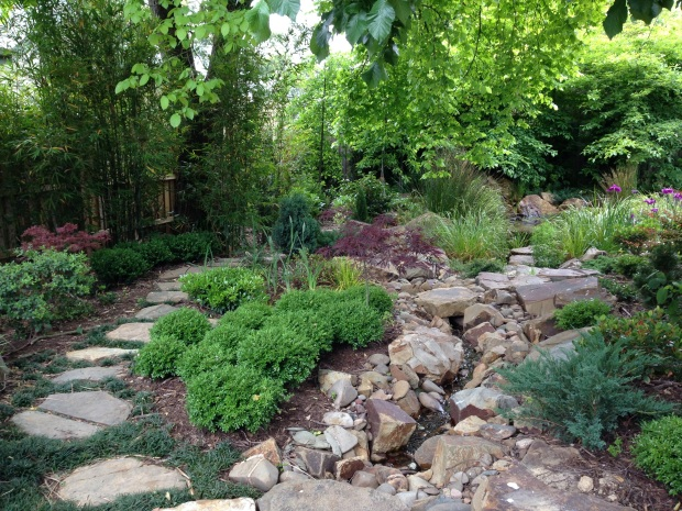 The pebble stream through the Japanese garden at Woodcote