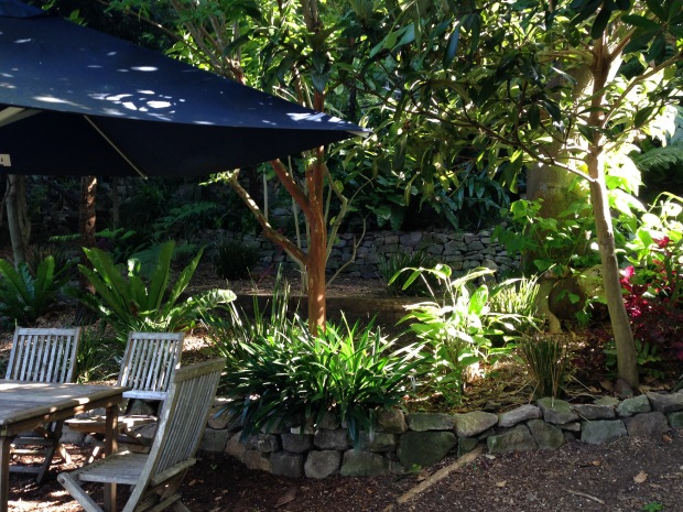 Cosy, shaded seating area at Wendy's Secret Garden