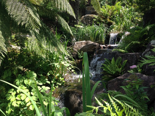 Naturalistic waterfall in the Rock Garden at Mount Tomah Botanic Garden