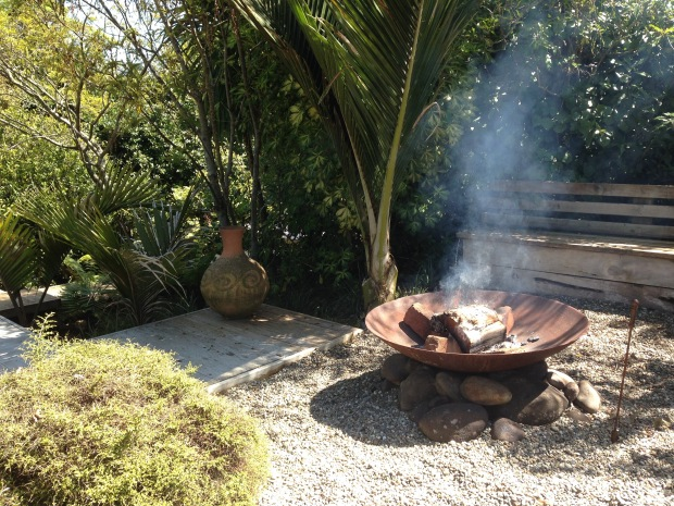 Fire pit with seating at Ann and Vince's garden Janna Schreier