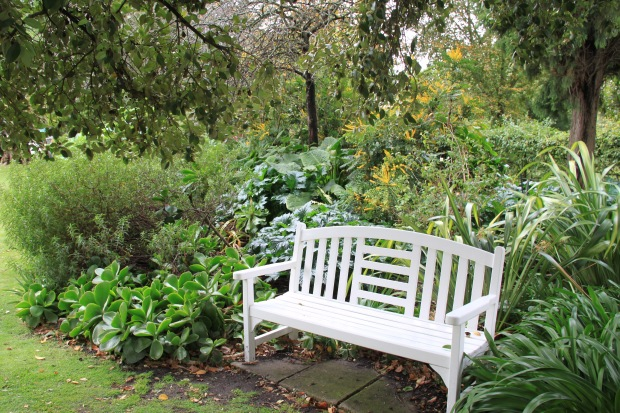 Classic white, timber bench at Cruden Farm. Janna Schreier