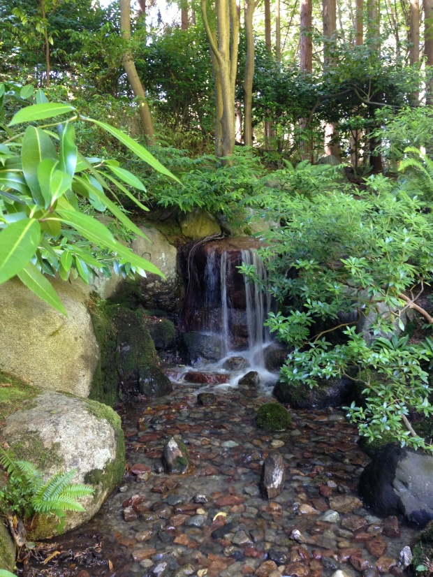 Carefully placed rocks create a beautiful waterfall at Nitobe Japanese Garden