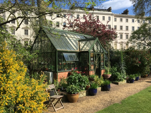 The beautiful greenhouse nestles into the trees, adding, rather than detracting from the garden's aesthetics