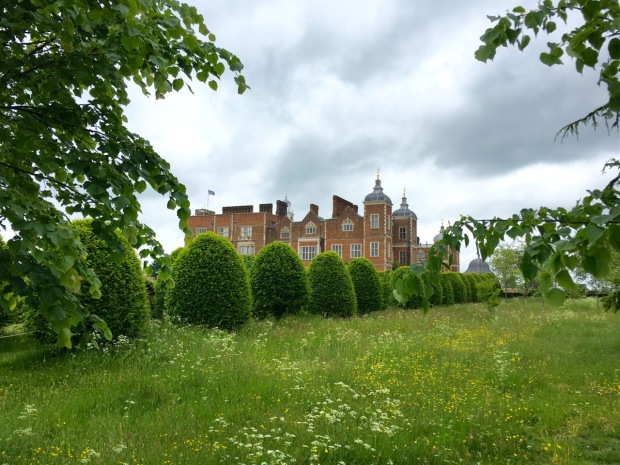 The contrast of topiary and meadow at Hatfield House