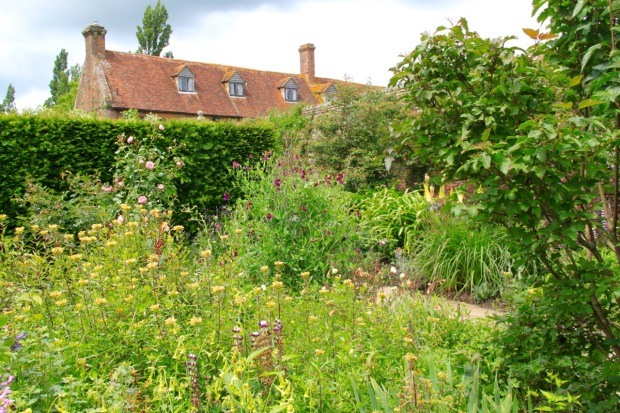 Old-fashioned plant species look quite the part against the backdrop of the listed building