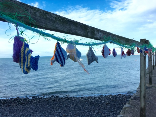 Knitted fish on the harbour wall at Clovelly