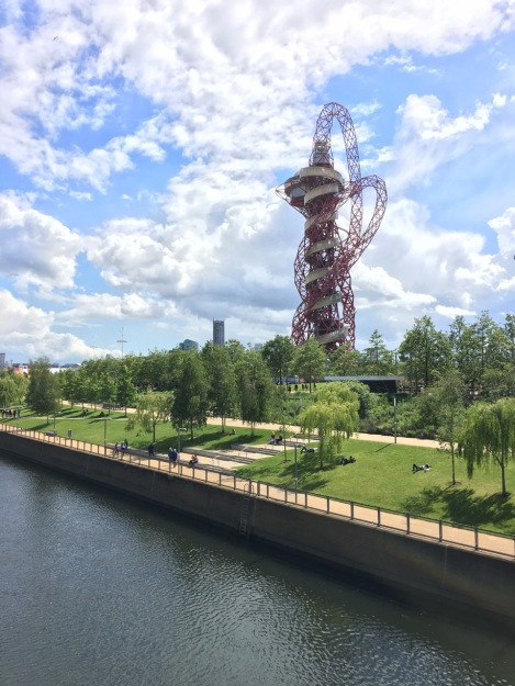 The iconic ArcelorMittal Orbit – the UK's tallest sculpture and slide – sits behind the River Lea, a relic of the Victorian industries in the part of London