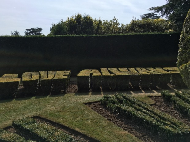 The Topiary Sundial is quite something. Golden yew forms the words 'Light and shade by turn, but love always' around the outside of the Buxus clock face