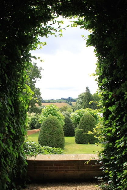 This back drop to the walled garden at Broughton Grange is a significant part of its charm