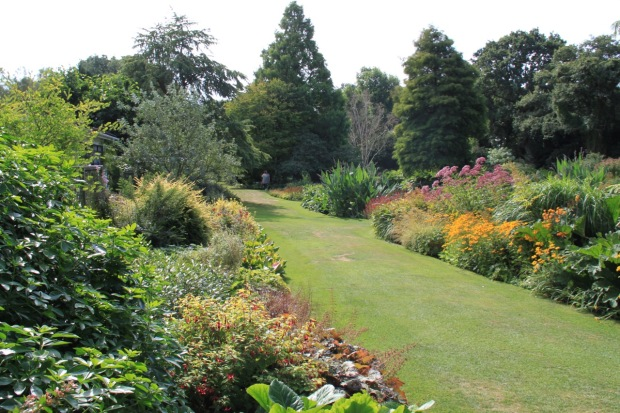 Traditional shrub and perennial borders in the Water Garden at Beth Chatto's