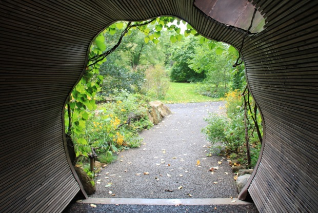 A bridge at Chanticleer was designed to represent a fallen tree trunk across the creek, through which you walk through