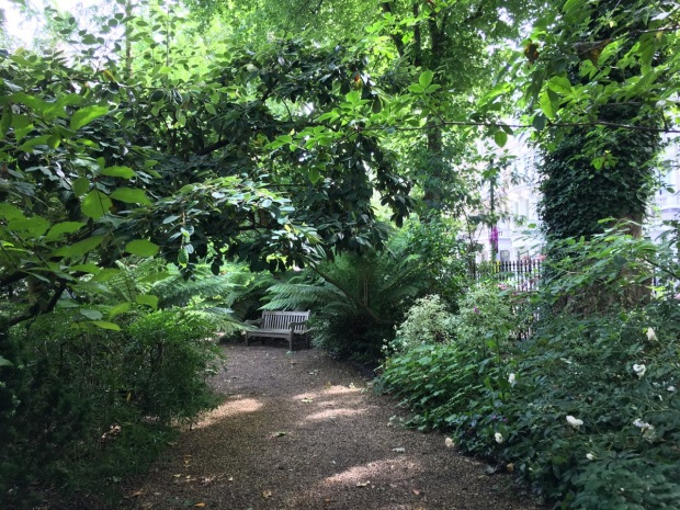 Informal, shady pathways contrast with the more open areas of Courtfield Gardens West